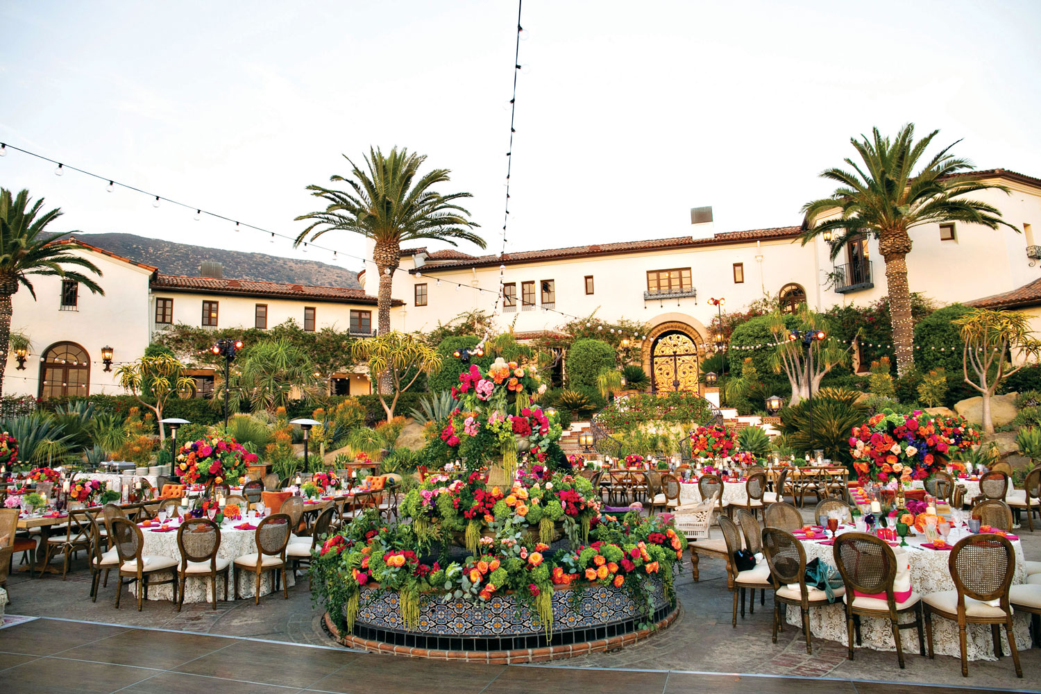 Inside Weddings magazine summer 2019 issue preview outdoor courtyard spanish style venue wedding reception colorful flowers