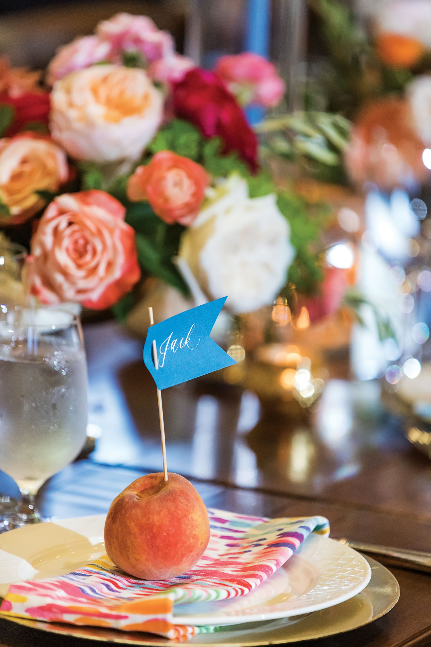 Inside Weddings magazine summer 2019 issue preview fresh peach place card holder colorful wedding reception