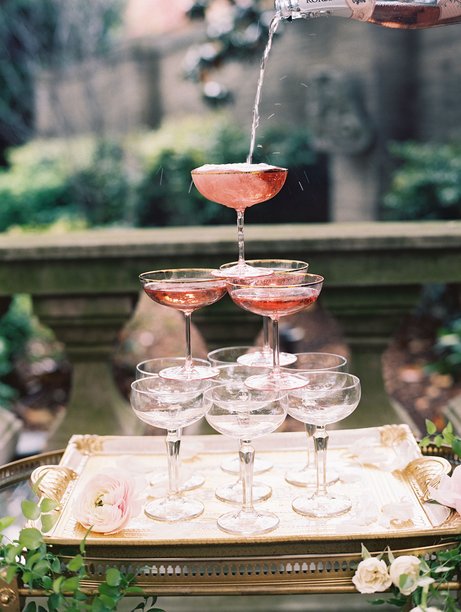 rose champagne tower on bar cart wedding ideas coupe glasses