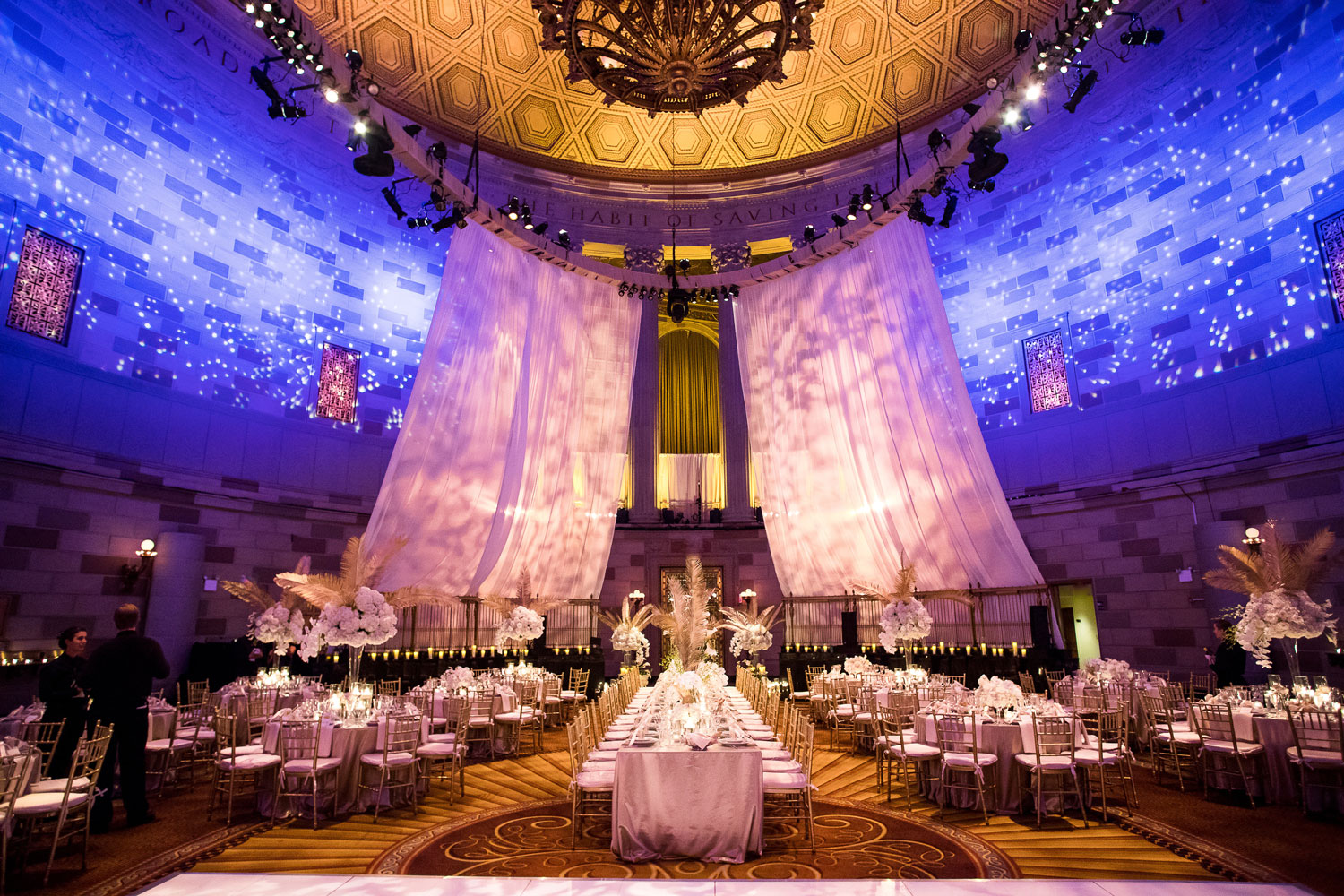 art deco style wedding reception tall ceilings lighting gold palm centerpieces gatsby wedding ideas