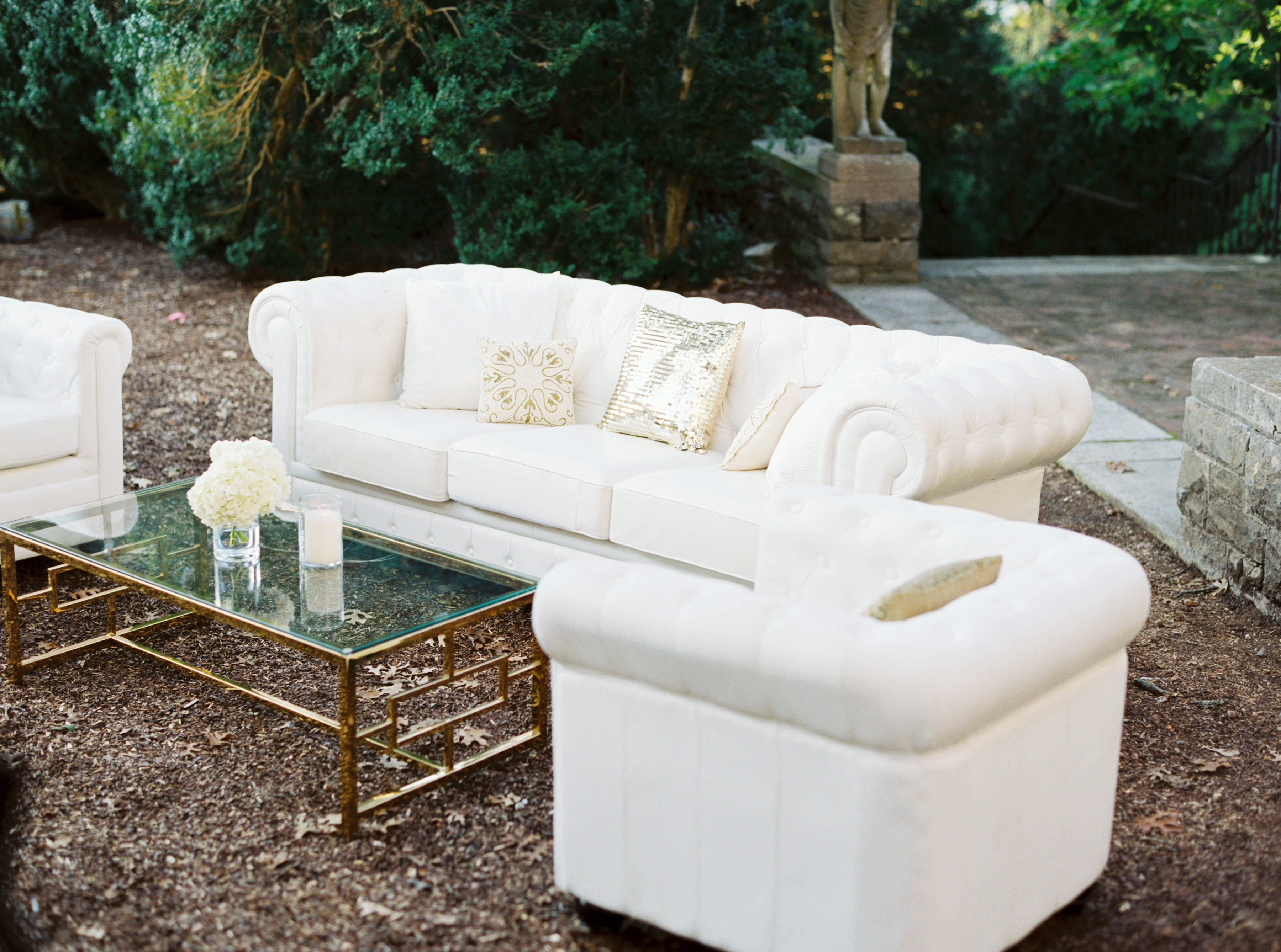 outdoor wedding reception lounge area, white lounge furniture sequin pillows