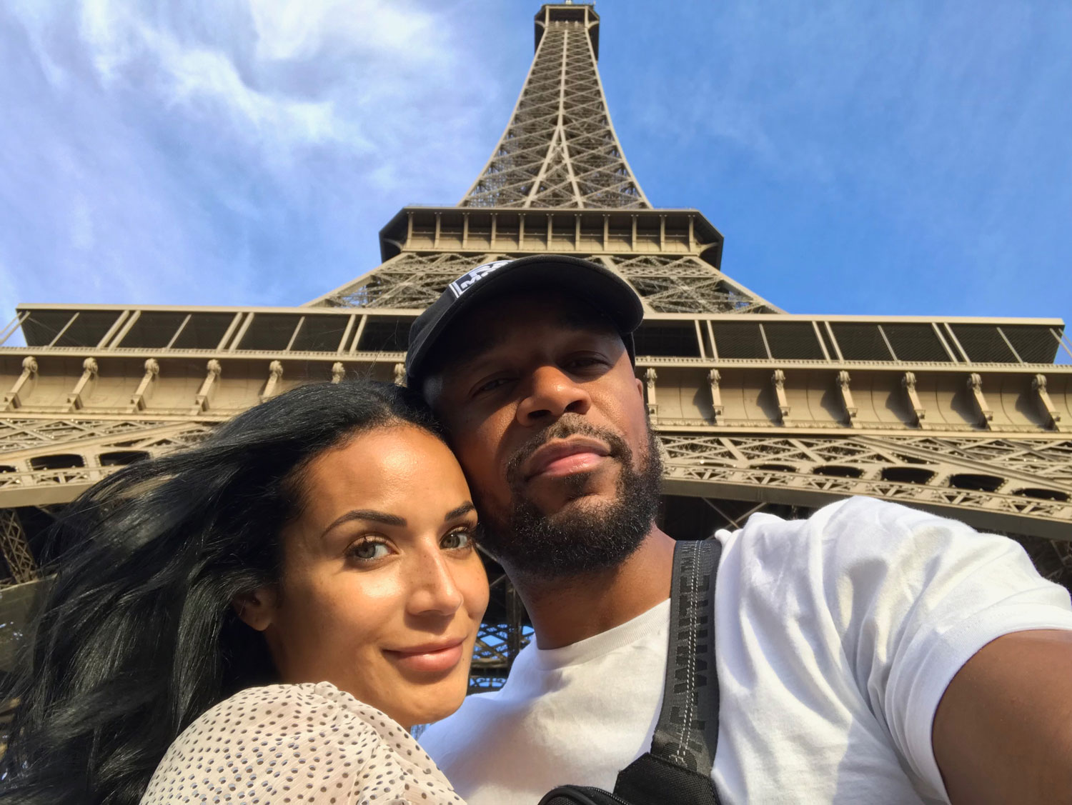 Zena Foster and Durrell Tank Babbs in front of eiffel tower paris france honeymoon