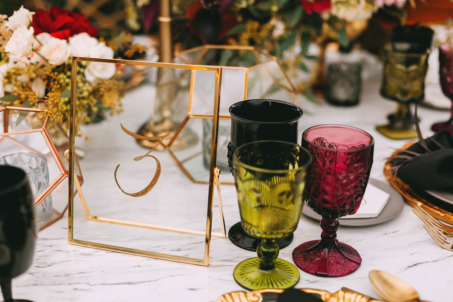 fall wedding marble table gold details colored goblet glassware drinkware