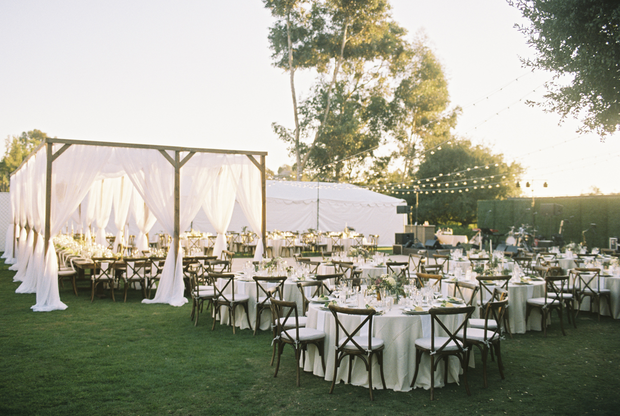 summer wedding ideas outdoor wedding venue with natural shade and drapery pergola