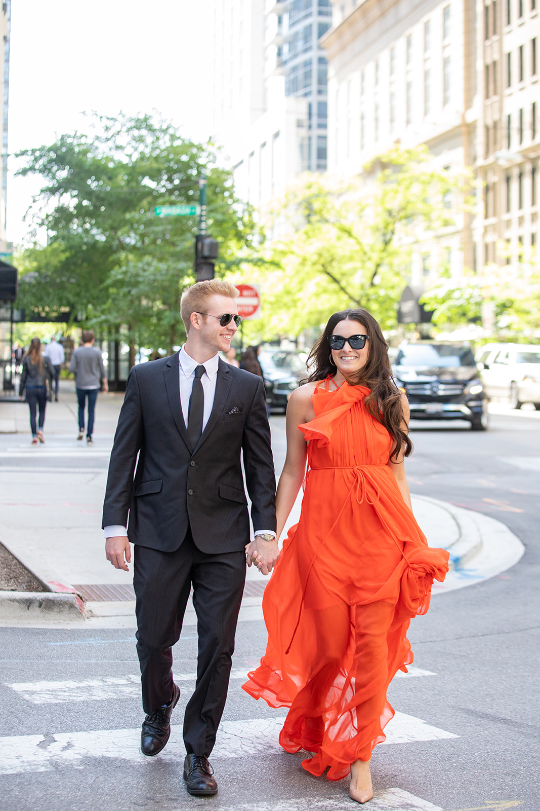 Chicago engagement photo shoot e-session collin pierson photography sunglasses walking across street city glam