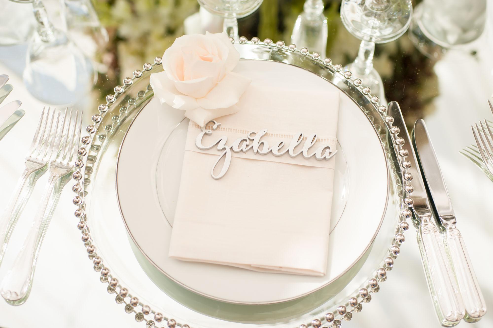 laser cut wedding ideas laser-cut metallic place card on reception setting