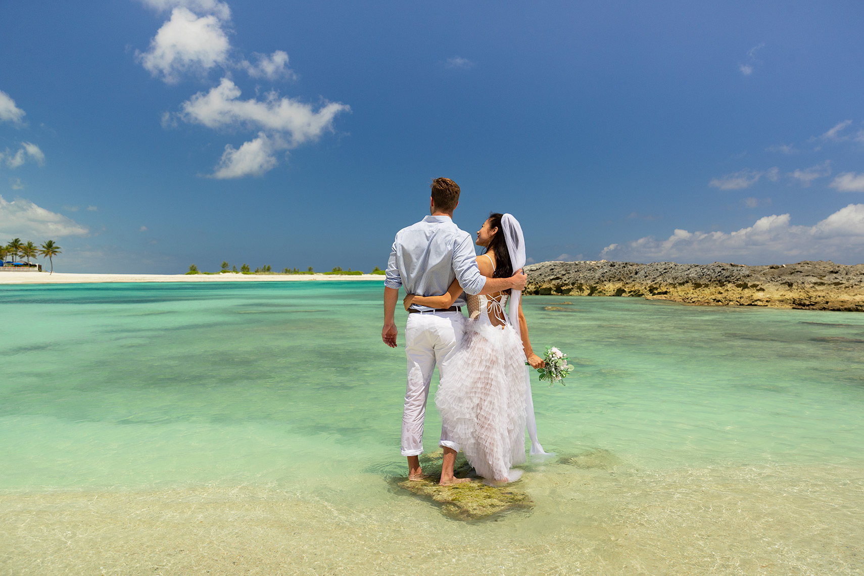 wedding at Atlantis Paradise Island destination wedding ideas in the bahamas bathing suit wedding dress