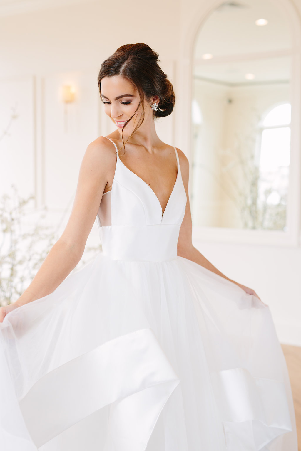 bride in wedding dress spaghetti strap low cut bodice full ball gown skirt a line dress