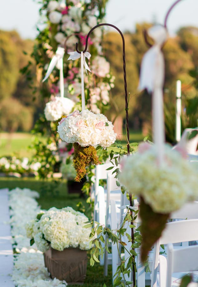 garden wedding ideas outdoor garden ceremony shepherd hooks moss flower petals aisle