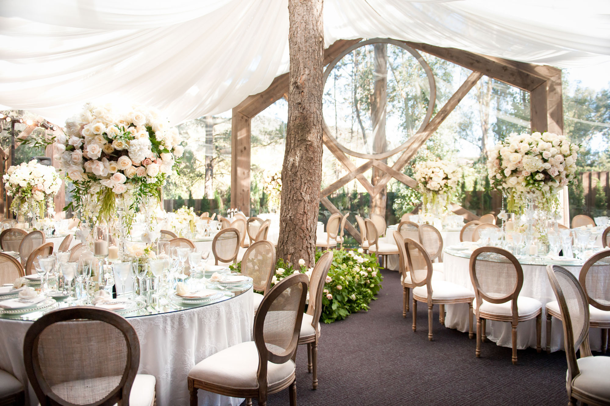 garden wedding ideas tent wedding reception clear tent wood chairs greenery centerpieces