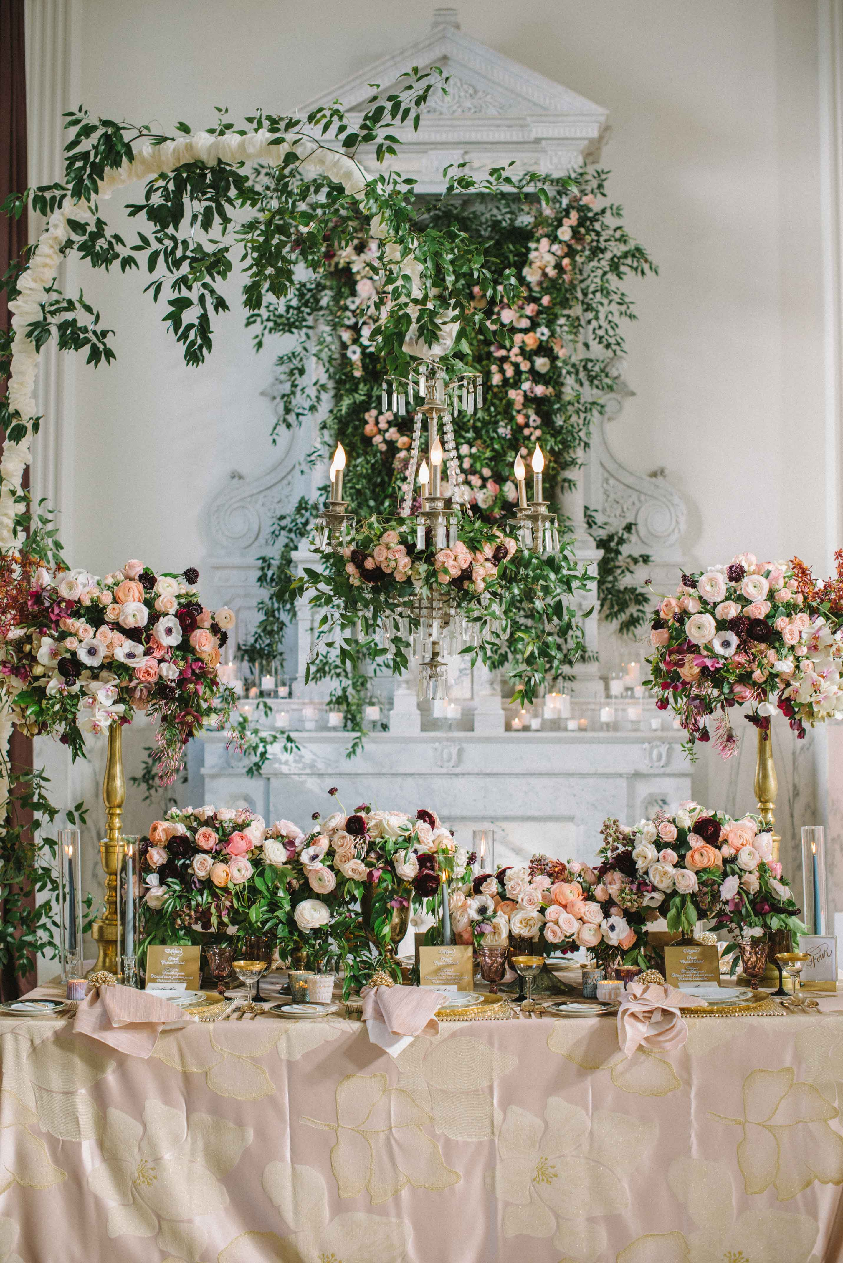 garden wedding ideas flower print linens at wedding reception table flower centerpiece floral chandelier