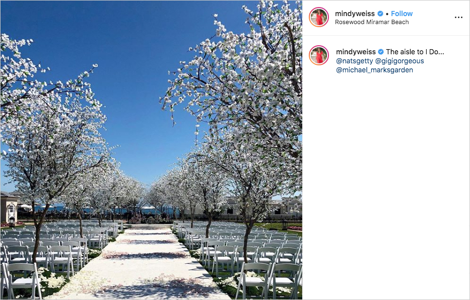 gigi gorgeous and nats getty wedding ceremony white cherry blossom trees line aisles