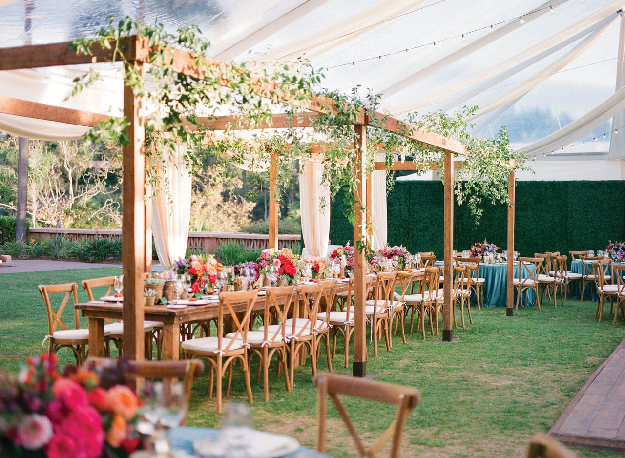 wedding reception outdoor pergola with extra flowers everafter events planning tip