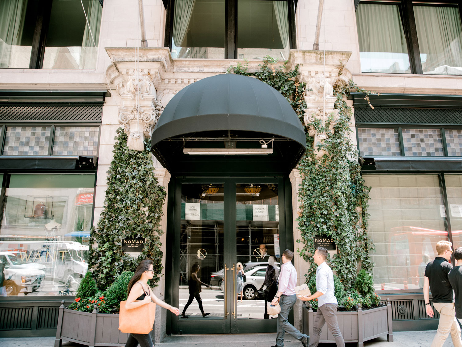 photo from the outside of the nomad hotel in new york, why couples should consider a mini-moon