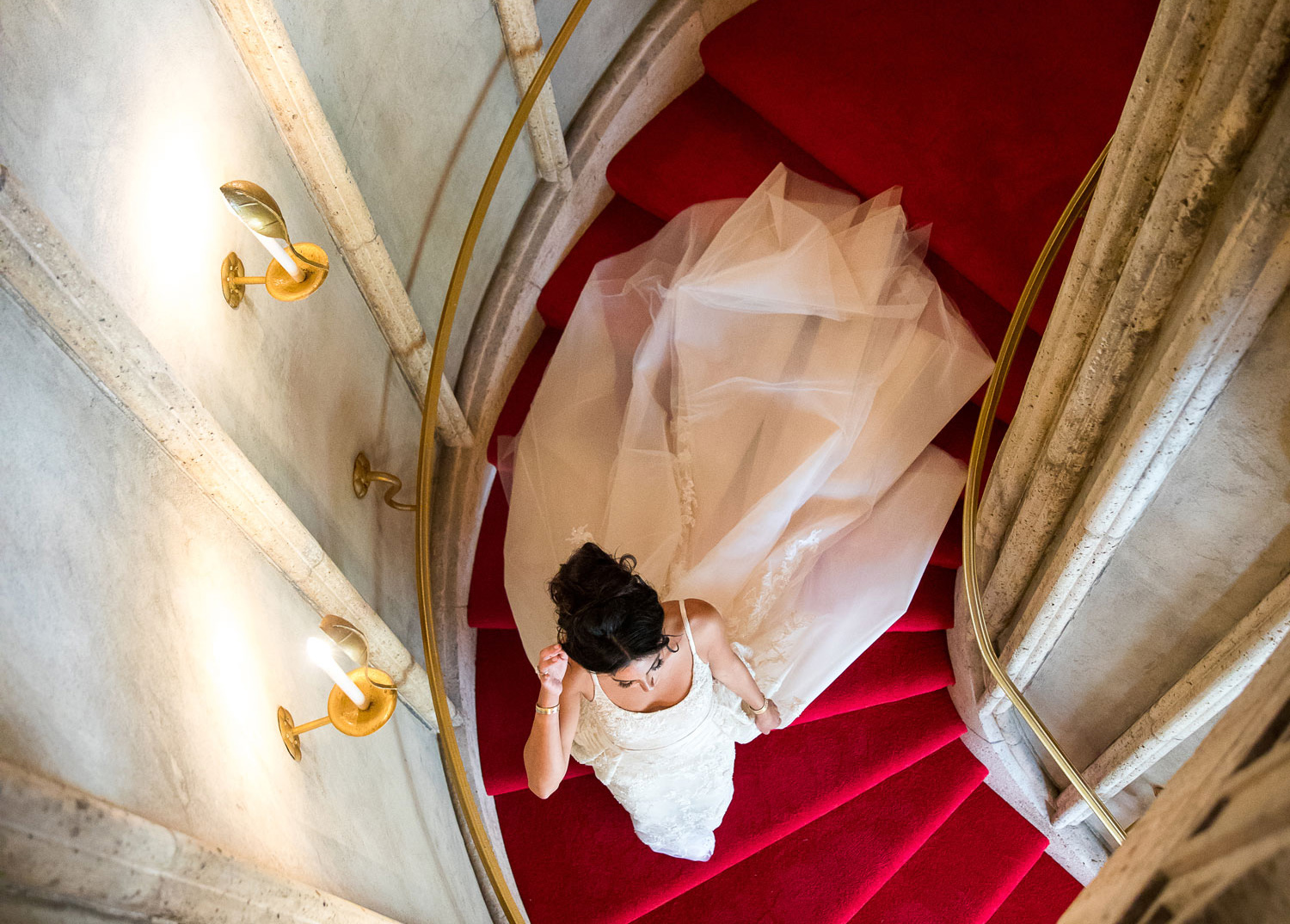 top view of bride in wedding dress with tulle train on staircase, timeline for buying wedding dress