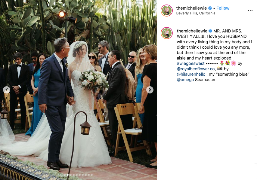 michelle wie in wedding dress walking down the aisle with her father