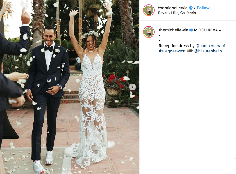 michelle wie in reception dress celebrating with husband johnnie west while guests throw rose petals