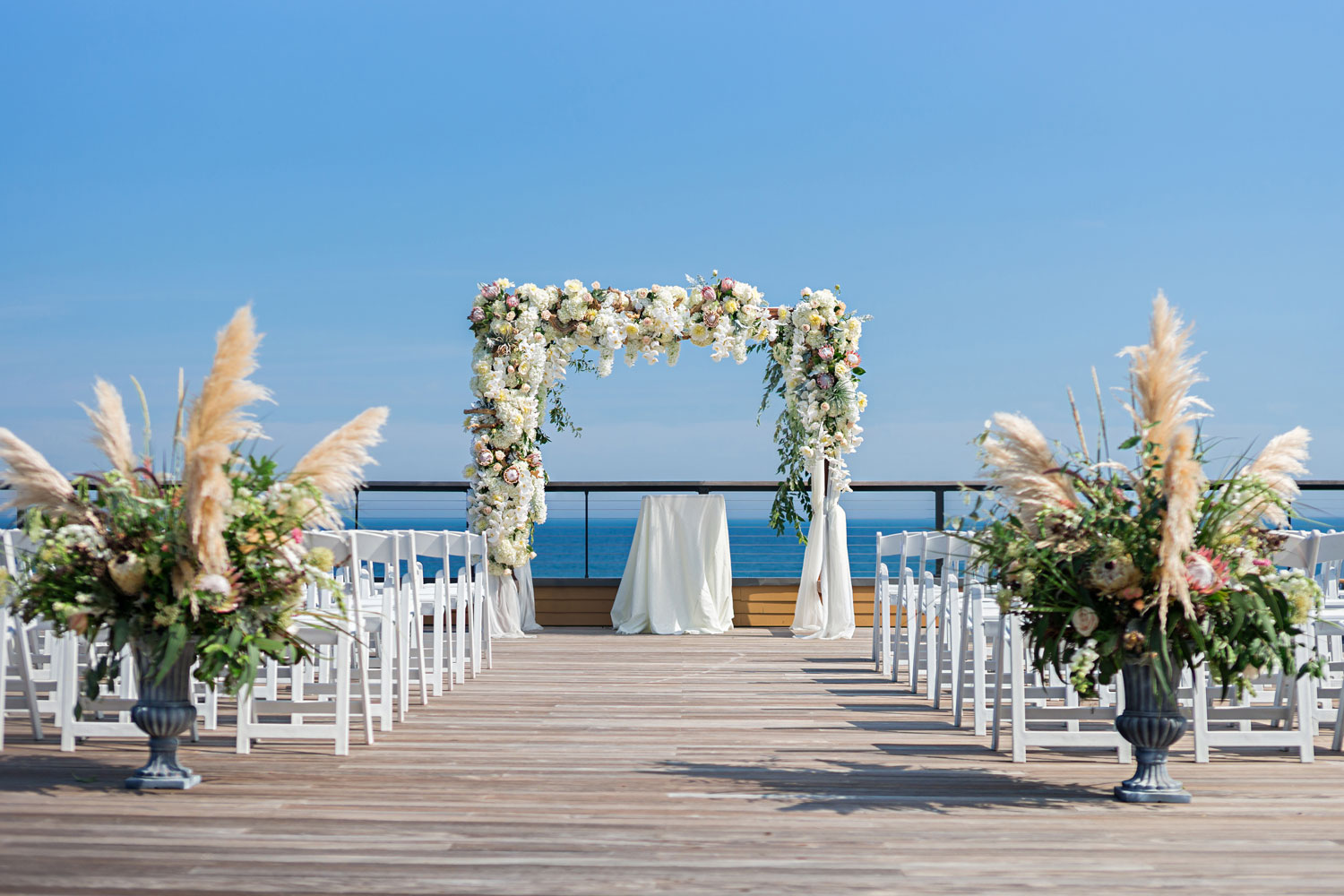 pampas grass wedding ideas ocean view ceremony with pampas grass decorations