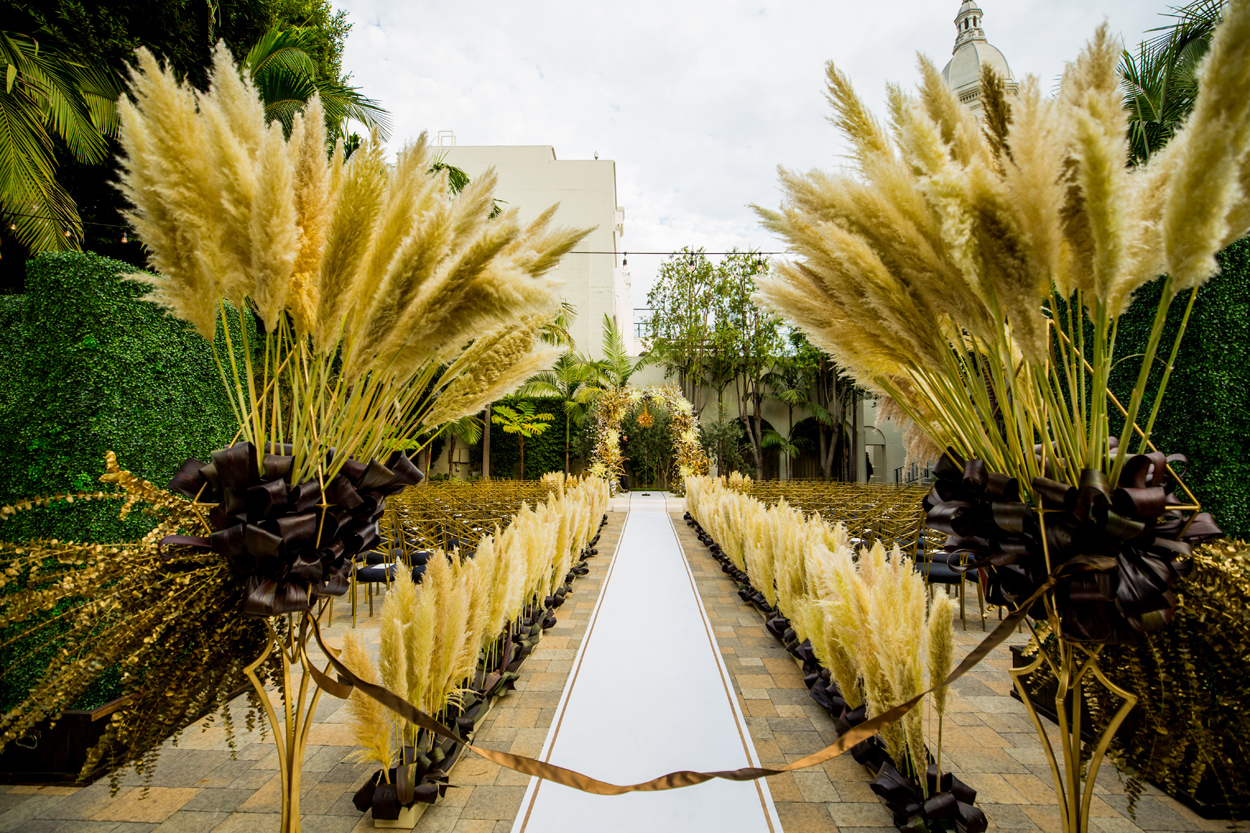 outdoor wedding ceremony pampas grass on aisle and chuppah