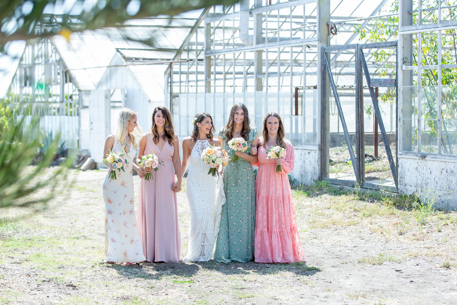 mismatched bridesmaids in different color dresses in varying styles