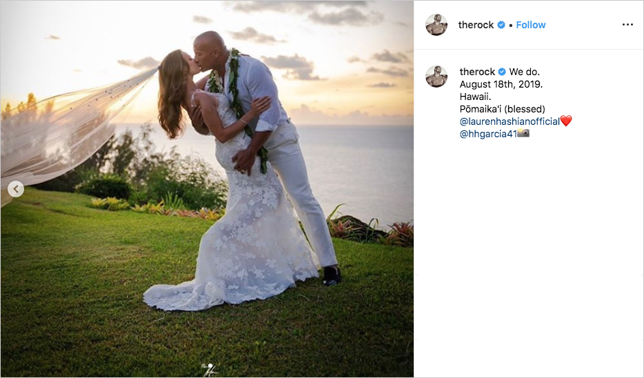 "dwayne ""the rock"" johnson kissing lauren hashian for wedding photo on bluff in hawaii"