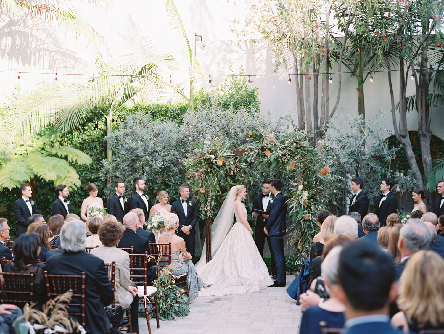 outdoor wedding ceremony with muted fall color palette neutral mindy weiss fall wedding trends