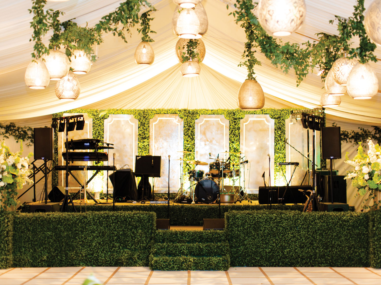 green hedge wall decorations at band stage reception wedding ideas