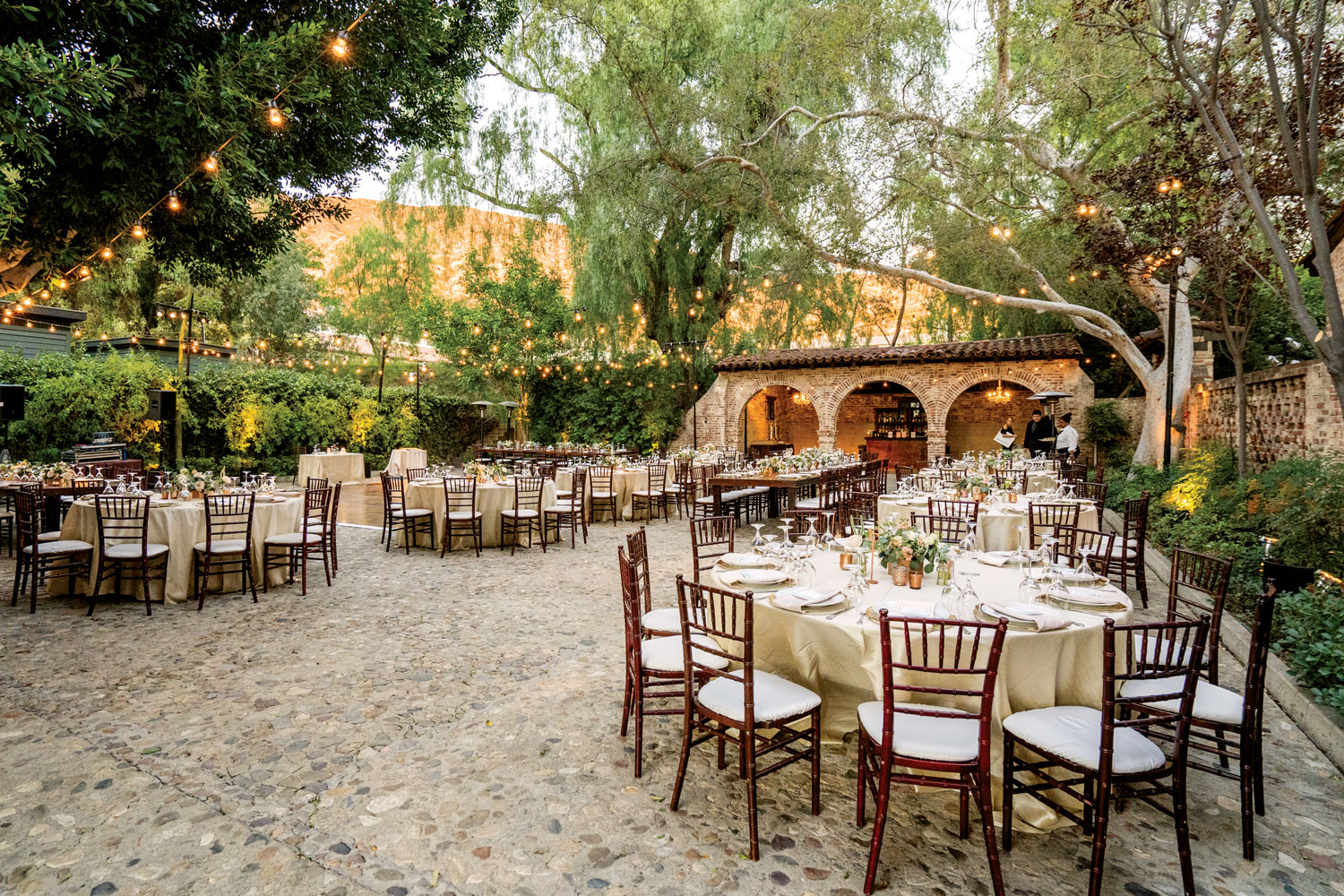 outdoor real wedding reception courtyard brick building luxe linen sterling engagements