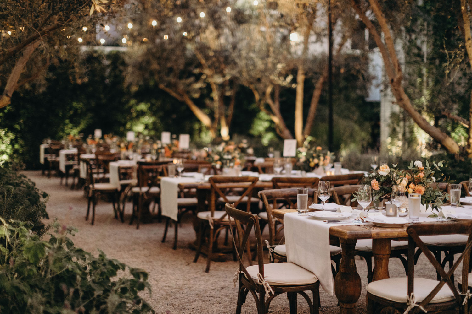 outdoor wedding reception dinner party rustic wood tables intimate setting vibiana