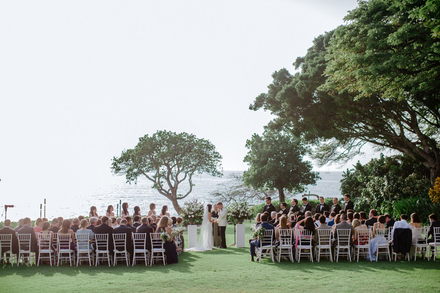 wedding ceremony on lawn in maui overlooking the ocean