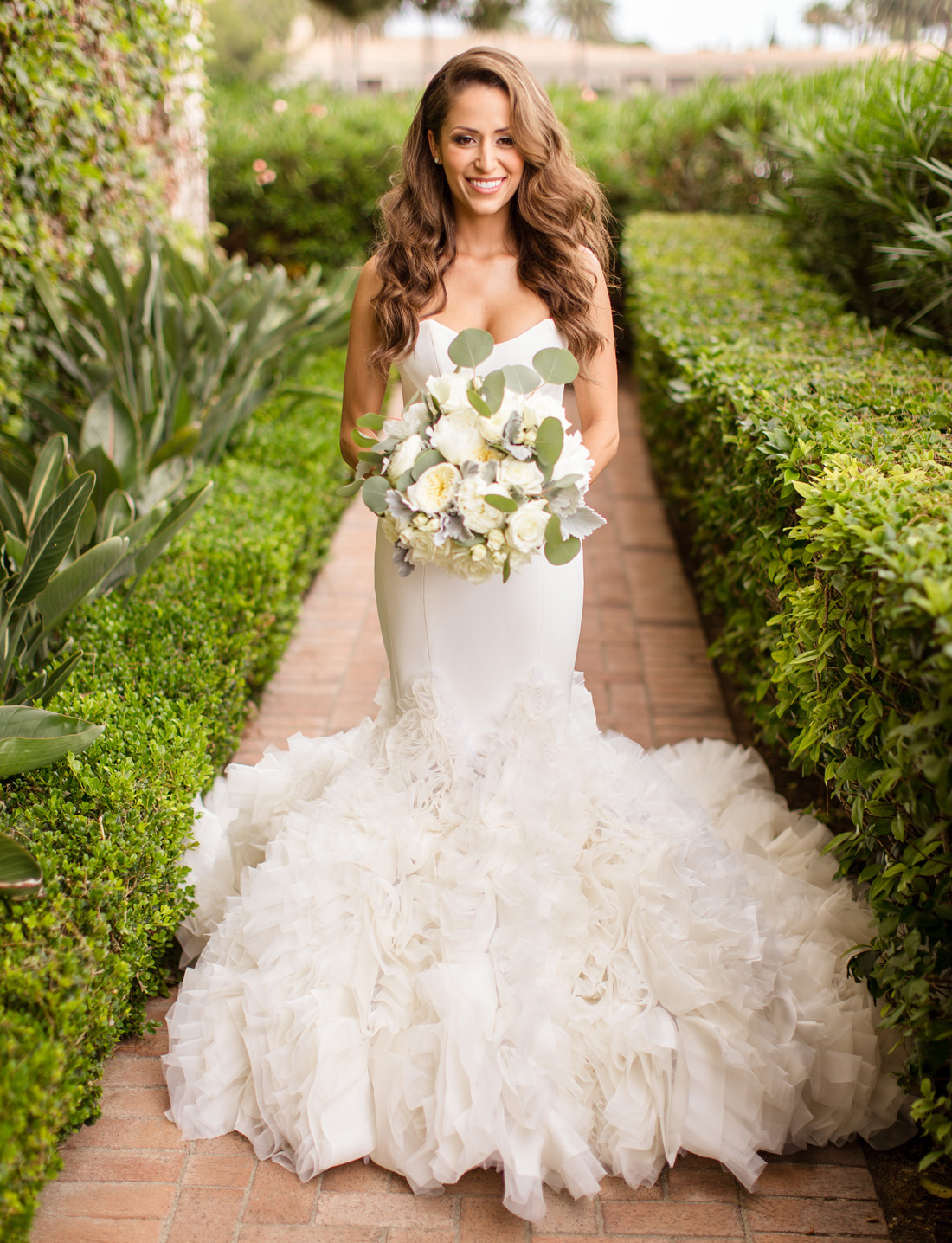 bride in fitted ines di santo crepe silk gown with full ruffled mermaid skirt
