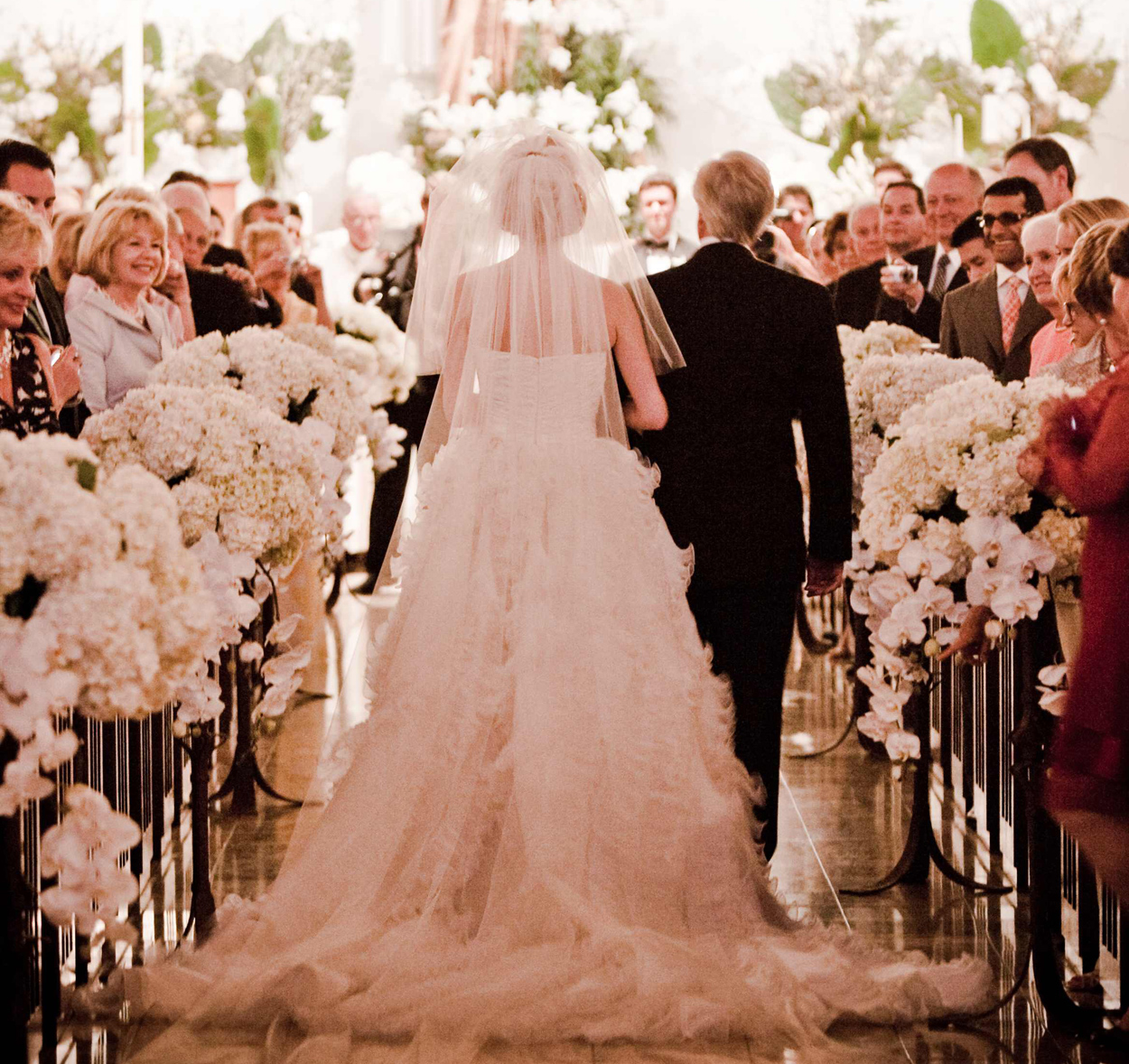 father walking his daughter down the aisle during a church wedding