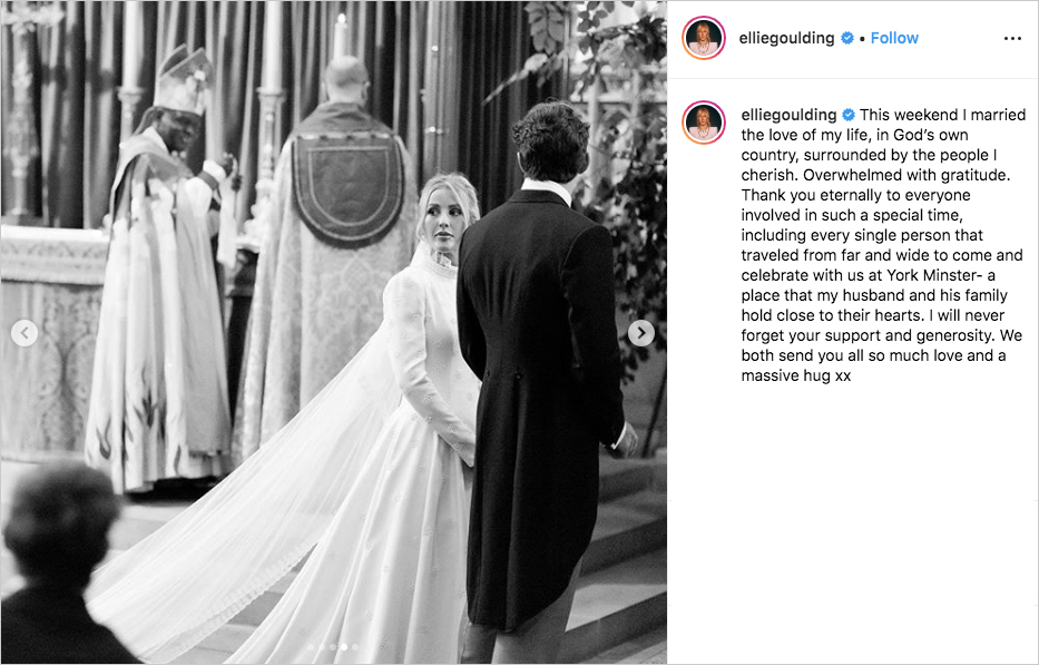 black and white photo of ellie goulding at her wedding as the bride looks back