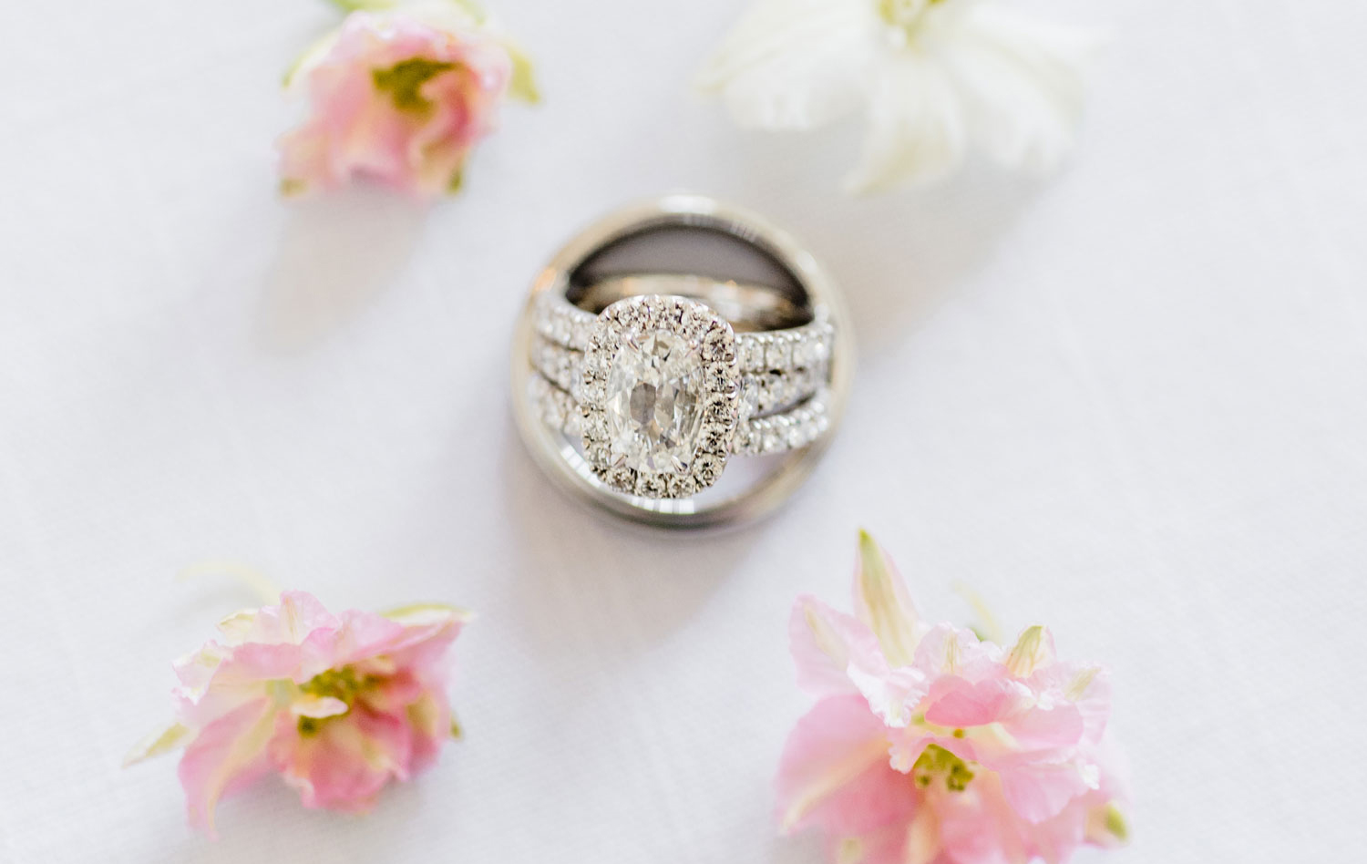 oval halo engagement ring between two eternity diamond rings, when not to wear your wedding ring