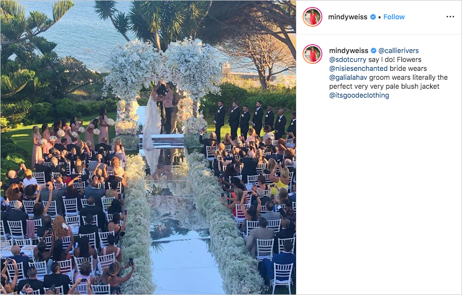 seth curry and callie rivers wedding in malibu with mirrored aisle and large floral arrangements