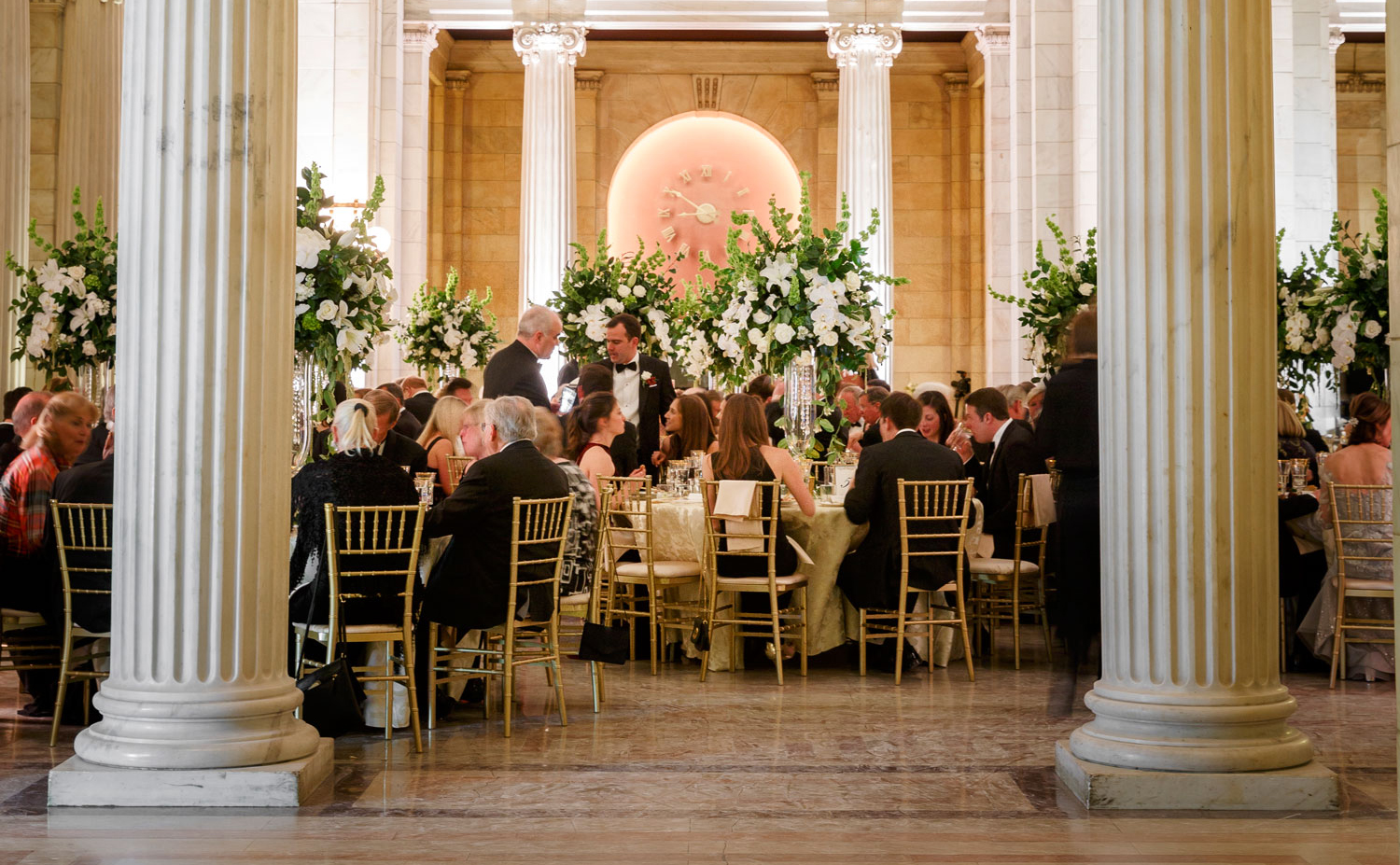 formal wedding guests seating at statehouse wedding reception with columns