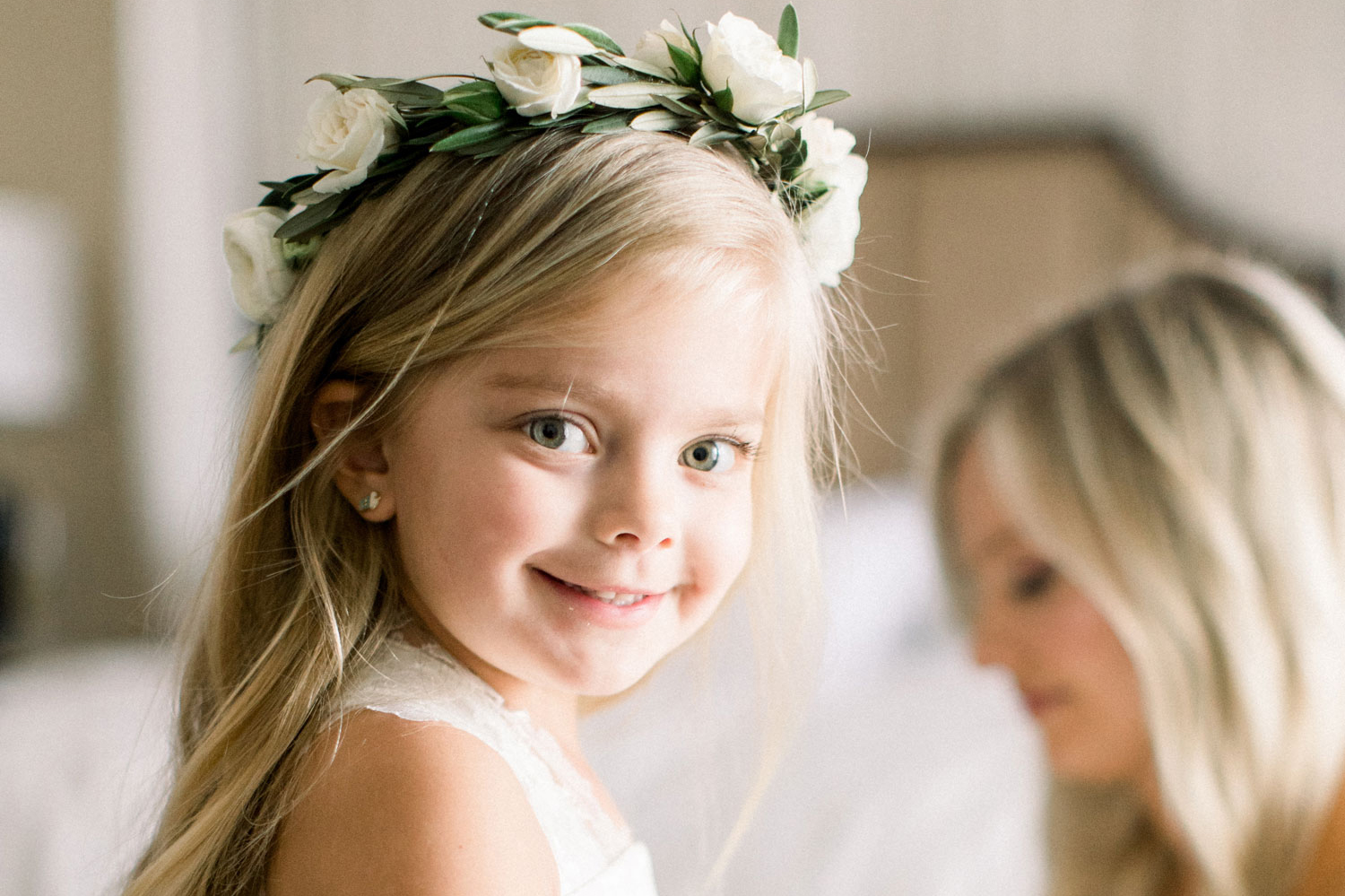 smiling flower girl wearing flower crown, how to tell your kids that you're engaged