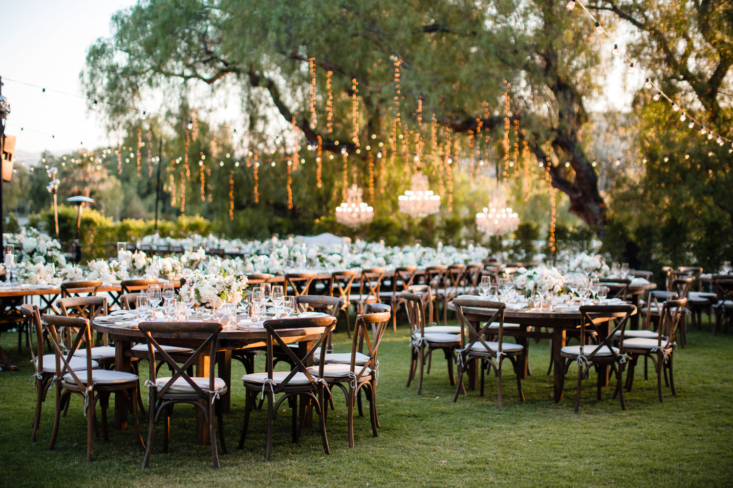 wedding reception outside twinkle lights vineyard wood chairs tables of 11 tessa lyn events