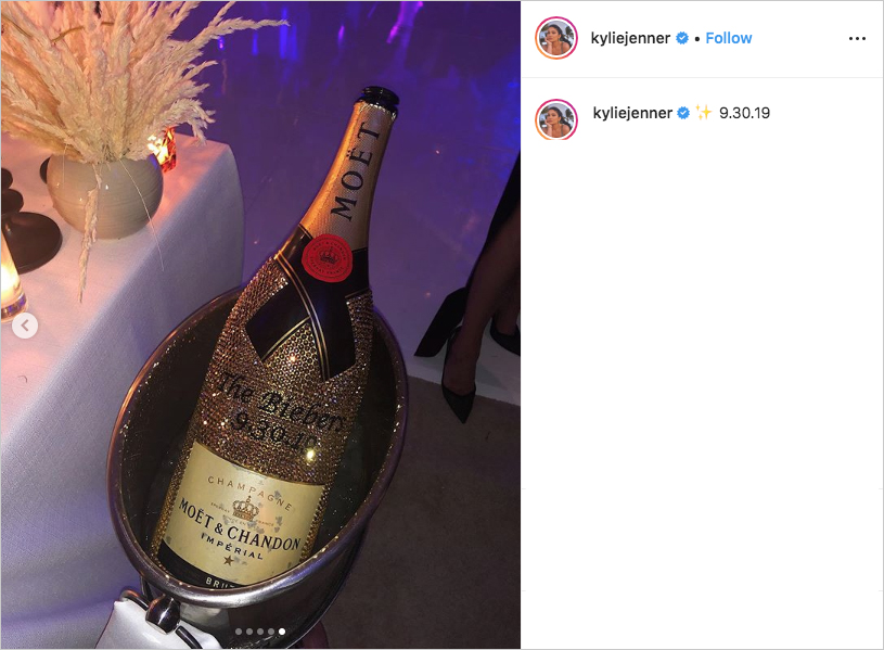 crystal encrusted moet bottle for Justin Bieber & Hailey Baldwin's wedding reception, pampas grass, purple lighting