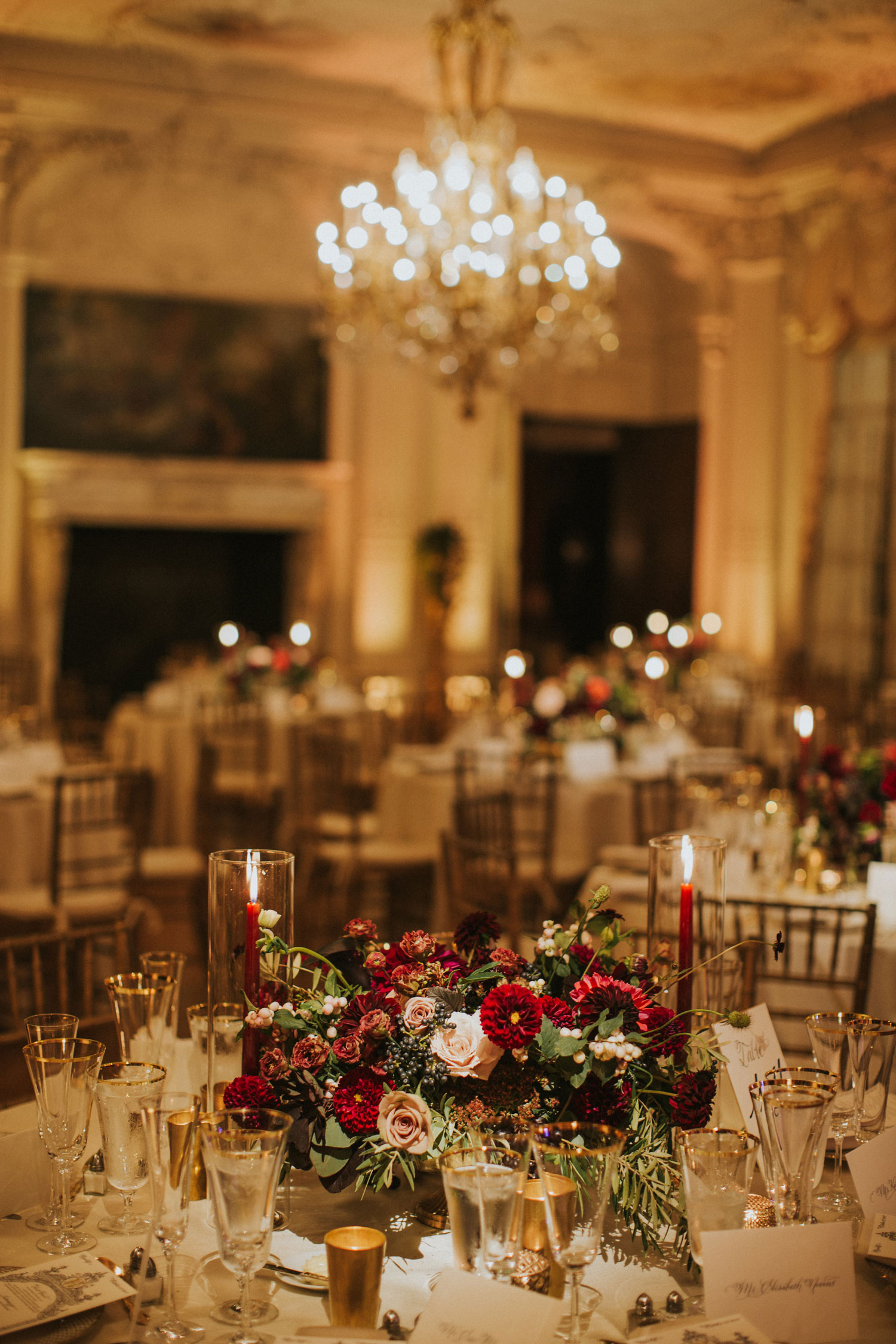 wedding reception tall ceilings fall autumn centerpieces low flowers burgundy