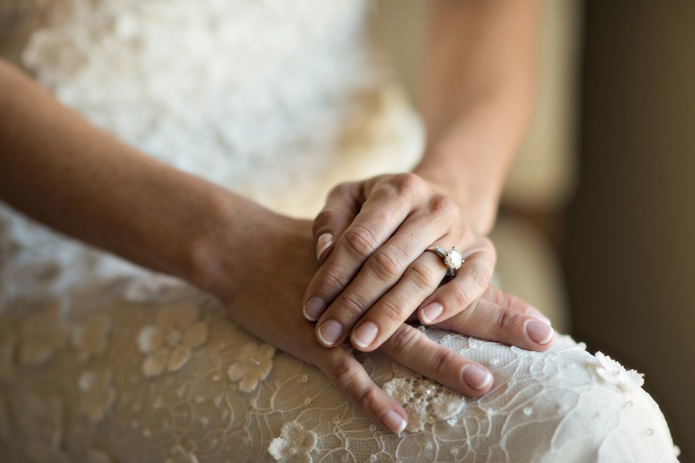 close-up of bride's hands with natural looking french manicure