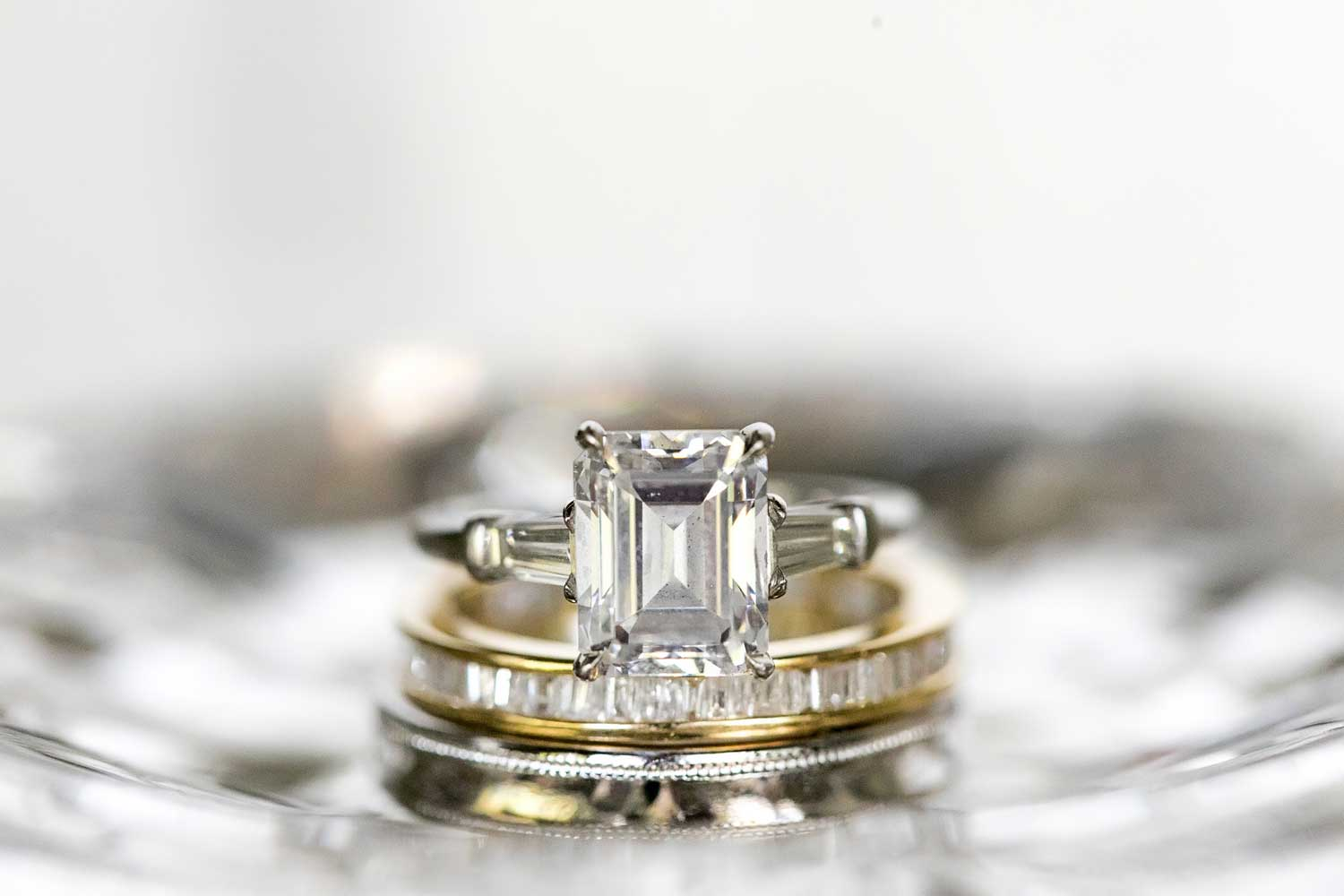 emerald cut diamond engagement ring with tapered baguette side stones, what your engagement ring setting says about you
