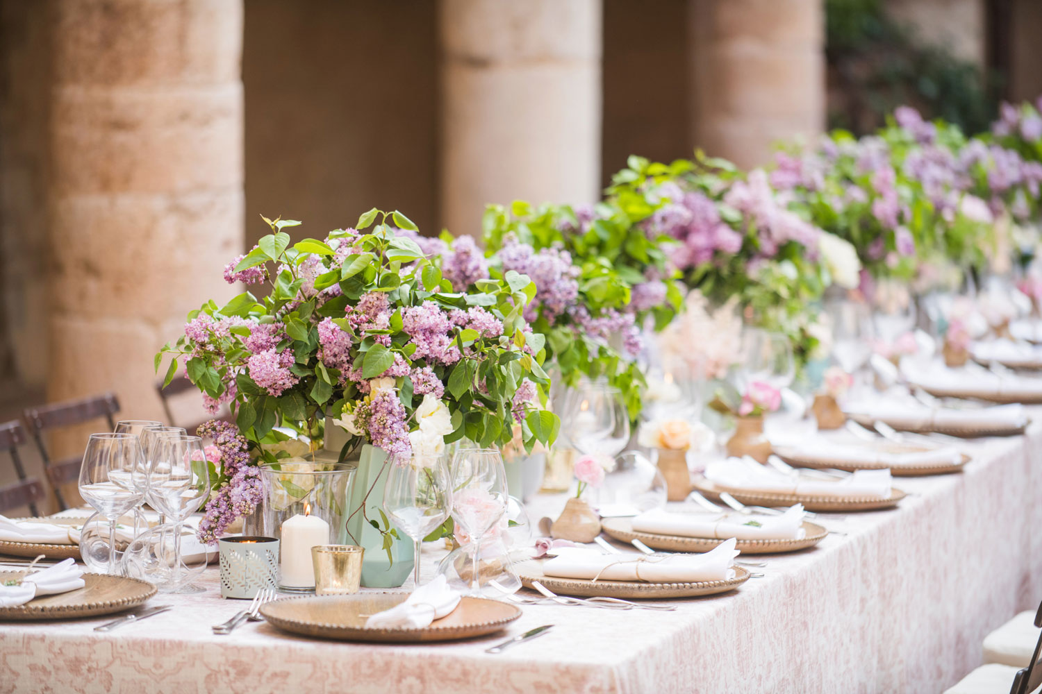 the benefits of having a smaller, intimate wedding, arrangements of pink and purple flowers