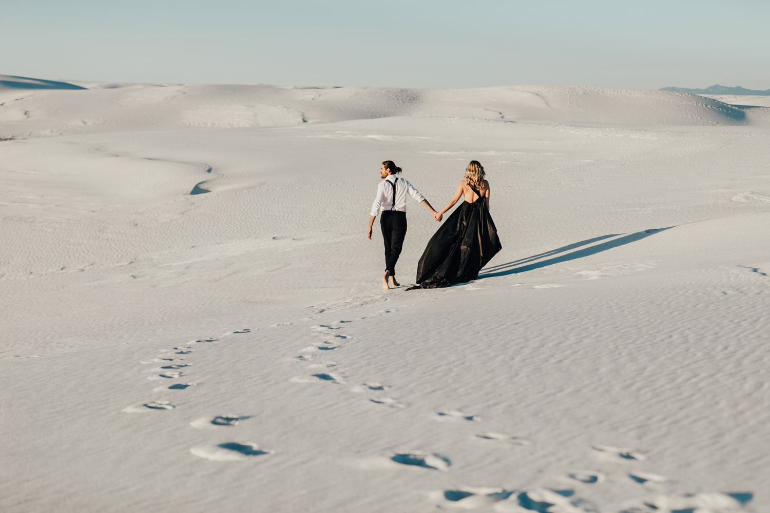 engagement photo shoot at White Sands National Monument in New Mexico engagement photos walking in sand