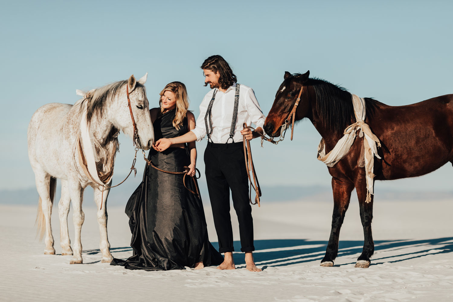 engagement photo shoot at White Sands National Monument in New Mexico engagement photos couple with horses