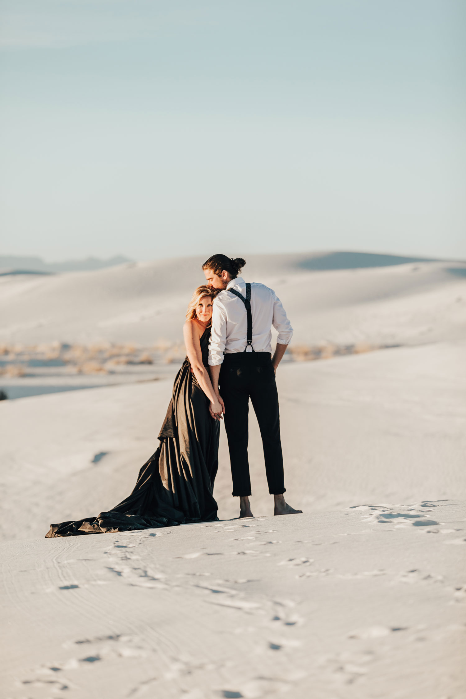 engagement photo shoot at White Sands National Monument in New Mexico engagement photos barefoot sunset photo