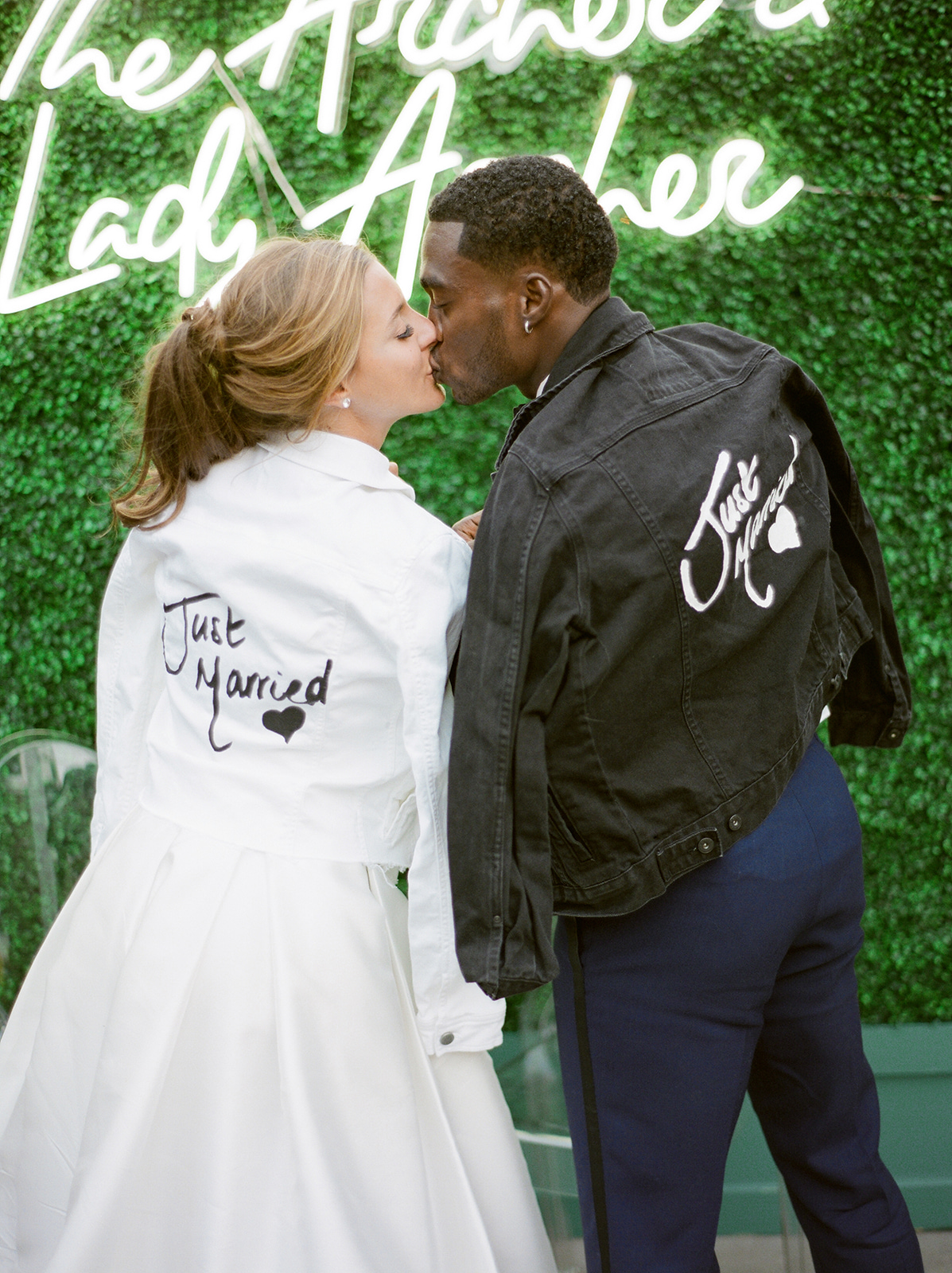 LA Rams NFL football player Brandin Cooks with wife in custom jackets after wedding