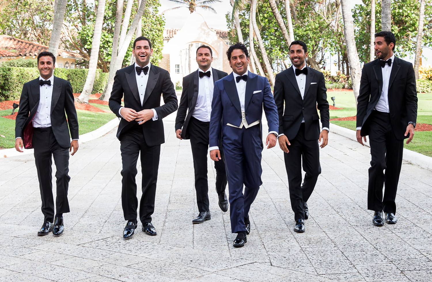 group of groomsmen walking pathway together, style tips for groomsmen
