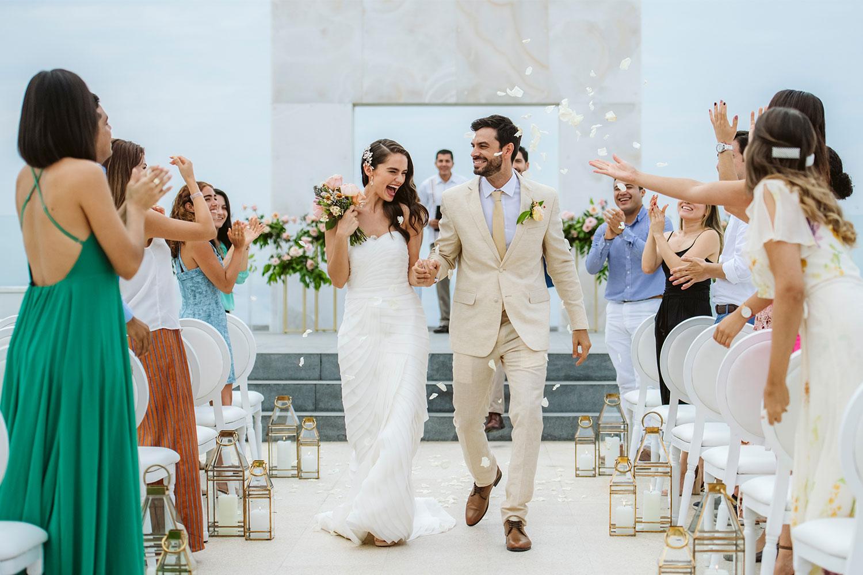 Le Blanc Spa Resort destination wedding in mexico bride and groom walk up aisle ceremony