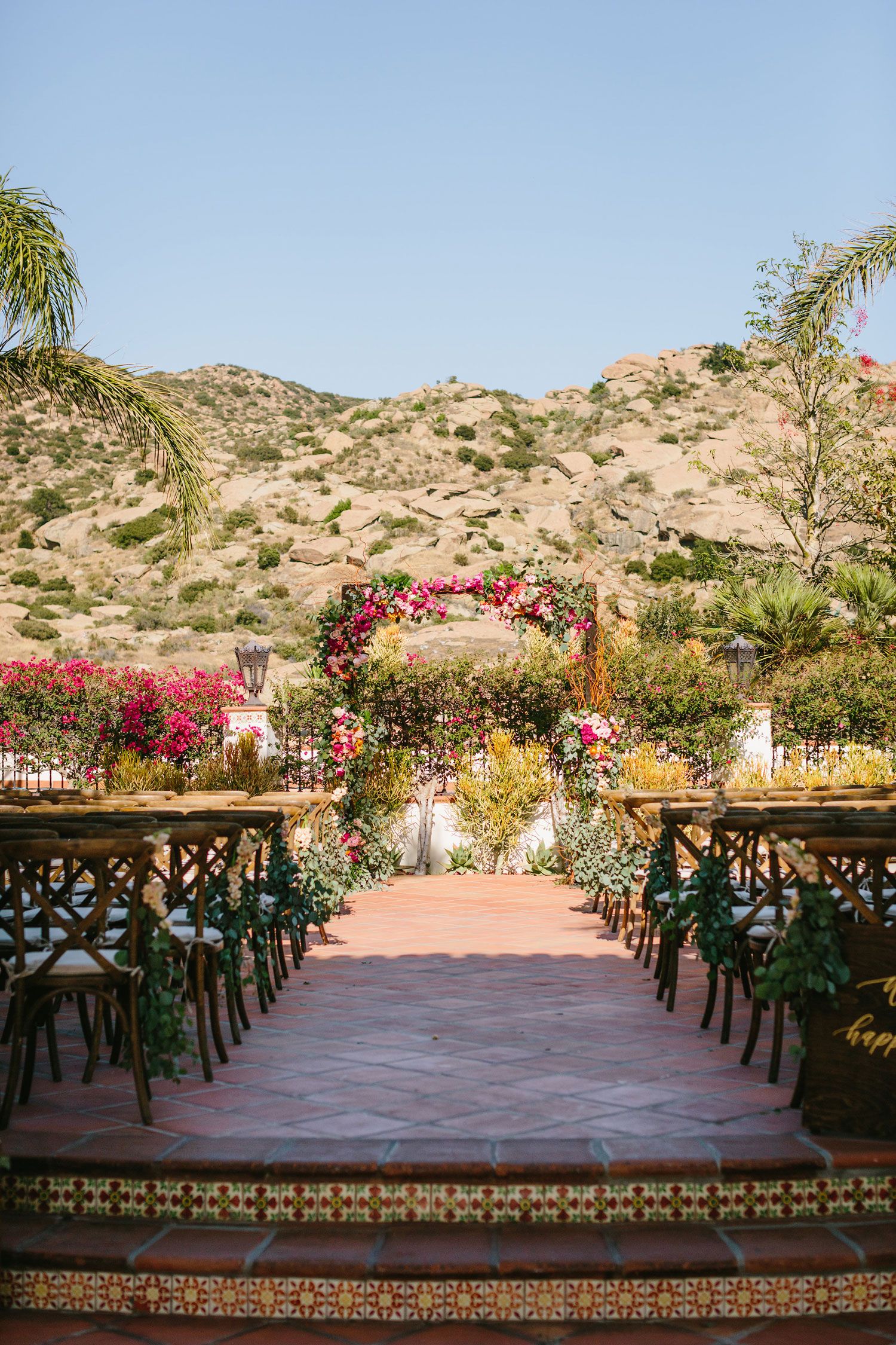 outdoor wedding ceremony at spanish style ranch courtyard